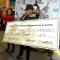 Chance the Rapper makes a $100,000 check presentation apart of the Get Schooled, #GetConnected Celebration.